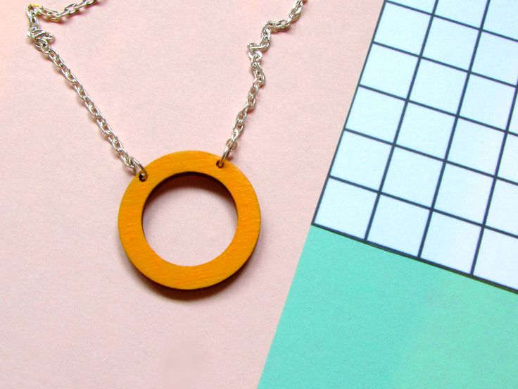 Simple, contemporary hoop necklace. Hand painted mustard yellow, made from sustainable birch wood #hoop #necklace #woodenjewellery #geometric #contemporary #minimal #jewellery #mustard #yellow #cutout #lasercut #sustainable #circle #circlenecklace #gift #giftsforher #anniversaryidea #anniversary #fiveyear
