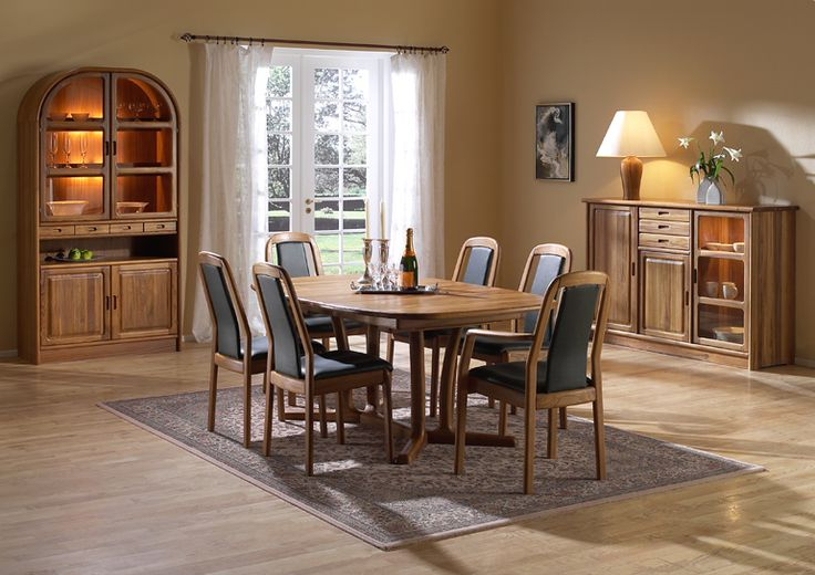 Dining Room Furniture | Dining Table There are a number of ways to build up your dyrlund dining room and this setting shows some of our best selling pieces. All our extendable tables are with finger friendly pulls and recessed latches. The photo shows: •1589 dining chair w/leather 40505 Green •1589A armchair w/leather 40505 Green •9243B/2 dining table •1122M highboard •1190M arch cabinet •1195M set of drawers Avail dining table and dining room furniture.