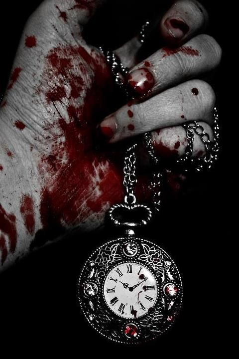 His bloody hands held up the clock necklace. He thought about what he did to get it back but..but it was the last thing he had of her.
