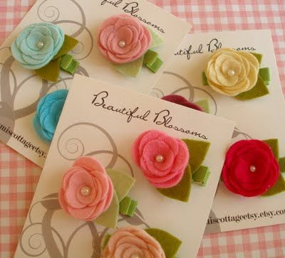 Cute little hair clips. No tutorial but you can find felt flowers on the handmade flowers board.