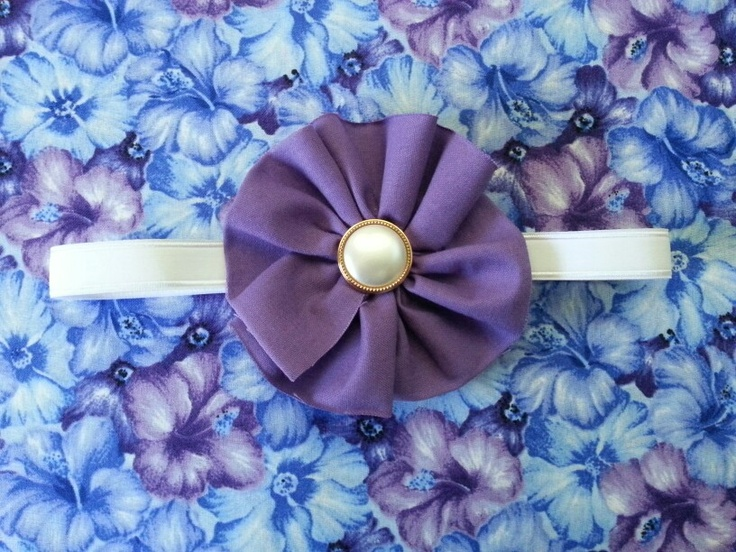 Purple headband with pearl button centre. From www.facebook.com/littlejadelittlepaige
