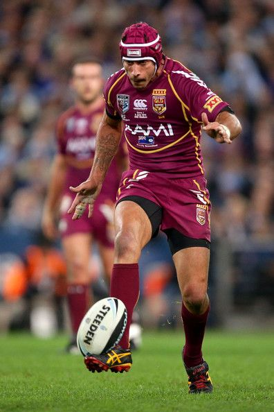 Johnathan Thurston of the Maroons kicks during game one of the ARL State of Origin series between the New South Wales Blues and the Queensland Maroons at ANZ Stadium on June 5, 2013 in Sydney, Australia.