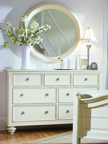 white round mirror over dresser - nursery