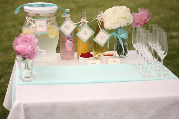 champagne infusion table, pom-pom flower centerpieces for Bridal Shower