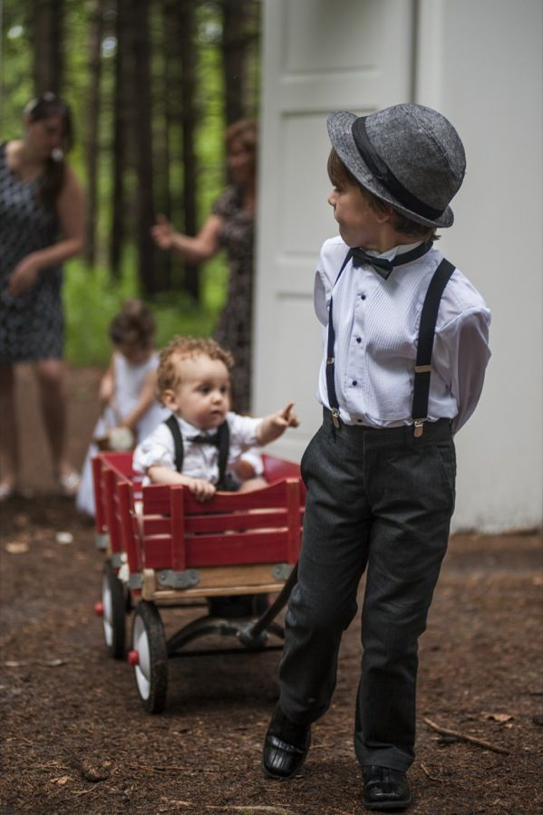outdoor wedding / ring bearers / wagon. We did this at our daughter's indoor wedding with a lil red Radio Flyer wagon, ring bearer pulled the flower girl, adorabale!