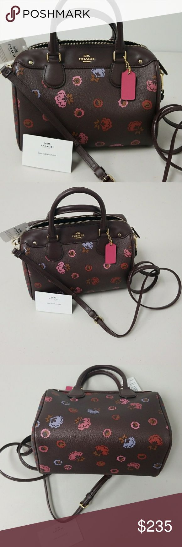 """NWT COACH Floral Bennett Bag NWT COACH Floral Bennett Mini Bag in Brown and Berry, Pink, and Purple Primrose with Goldtone hardware and zip closure.   Interior lined in coordinating berry/brown fabric with 1 zip pocket and 1 open bill slot.  9.5""""x7×5"""" with 48"""" adjustable leather drop strap and 4.5"""" double hands Coach Bags"""