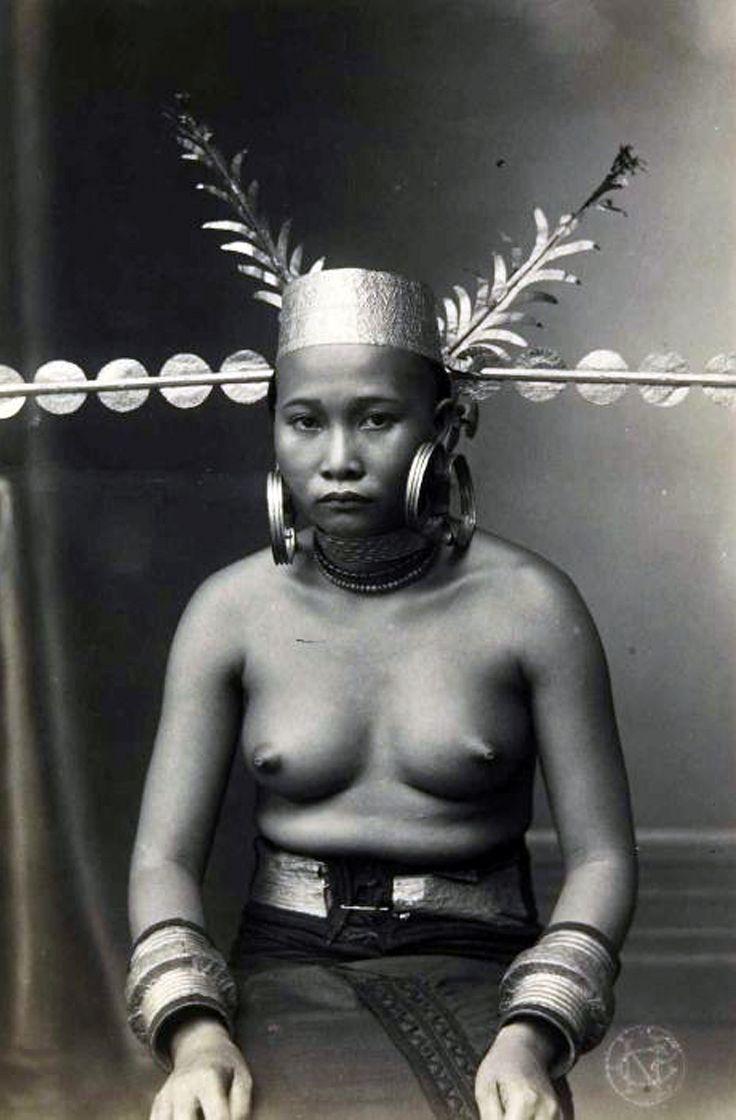 Indonesia ~ Sumatra, Nias | Studio portrait of a women, taken between 1892 and 1992 by Christiaan Benjamin Nieuwenhuis
