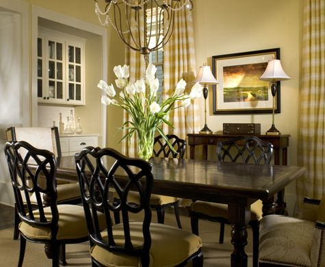 A dining room with dark furniture and built in cabinetry  lightened by  light colored seats  walls  curtains. 613 best Dining Rooms images on Pinterest   Dining room design