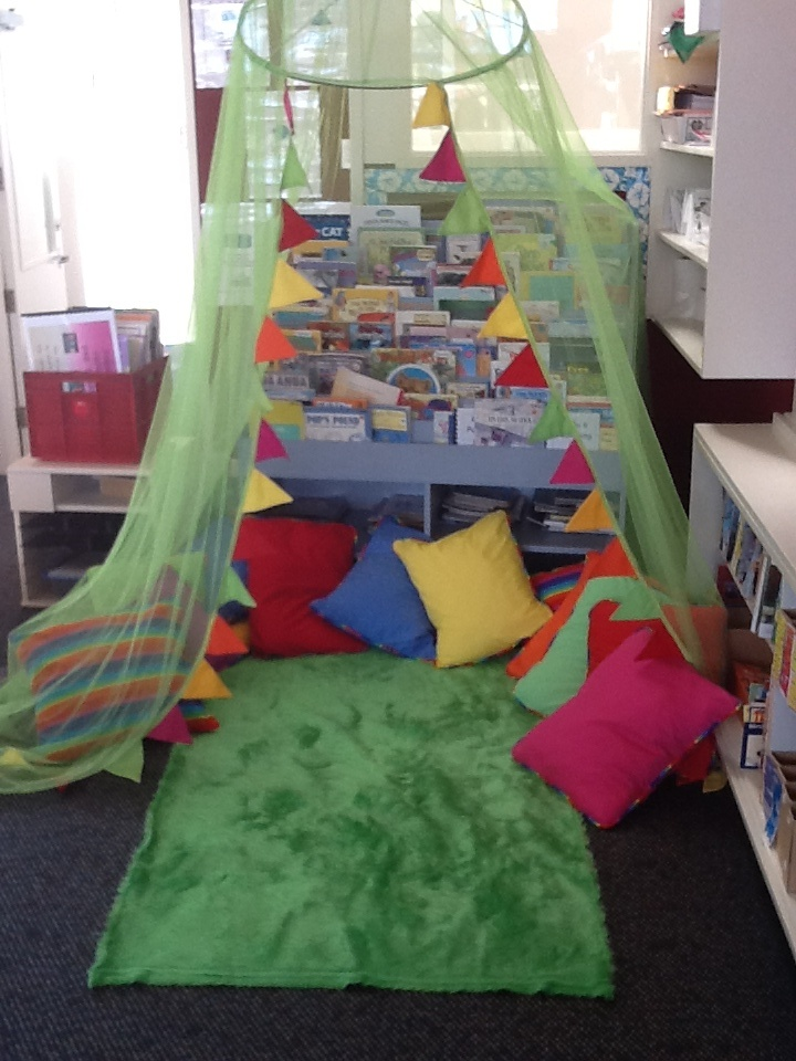 My reading corner mosquito net with added bunting shaggy material made into a rug  Reading