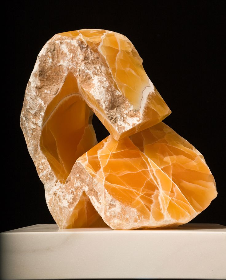 I would love to get this abstract stone sculpture for my fiance in his new office space. He would really enjoy the yellow honey color since it is such a soothing hue. The lines inside also create a natural comfort.