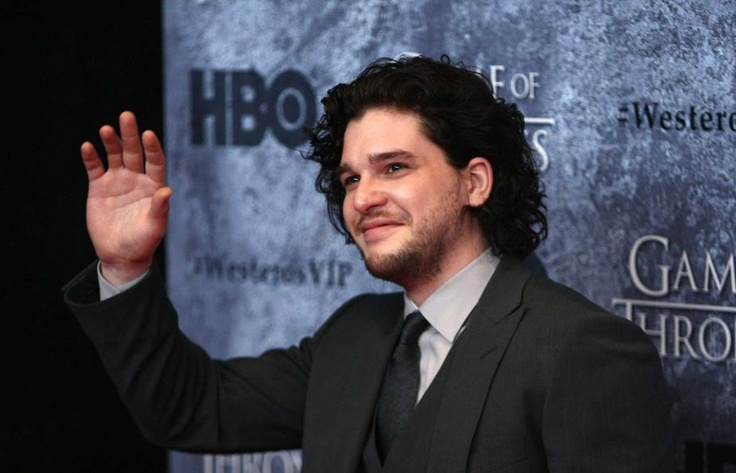 Kit Harrington, who plays Jon Snow, waves to gathered fans during the Seattle premiere of season thr