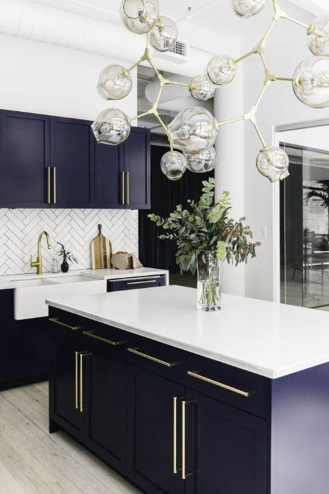This stunning navy blue kitchen is a favorite hangout spot