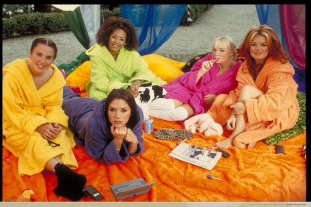 There is a cellphone and a laptop in this picture. | 43 Reasons Why The Spice Girls Are The Best Girl Group Of AllTime