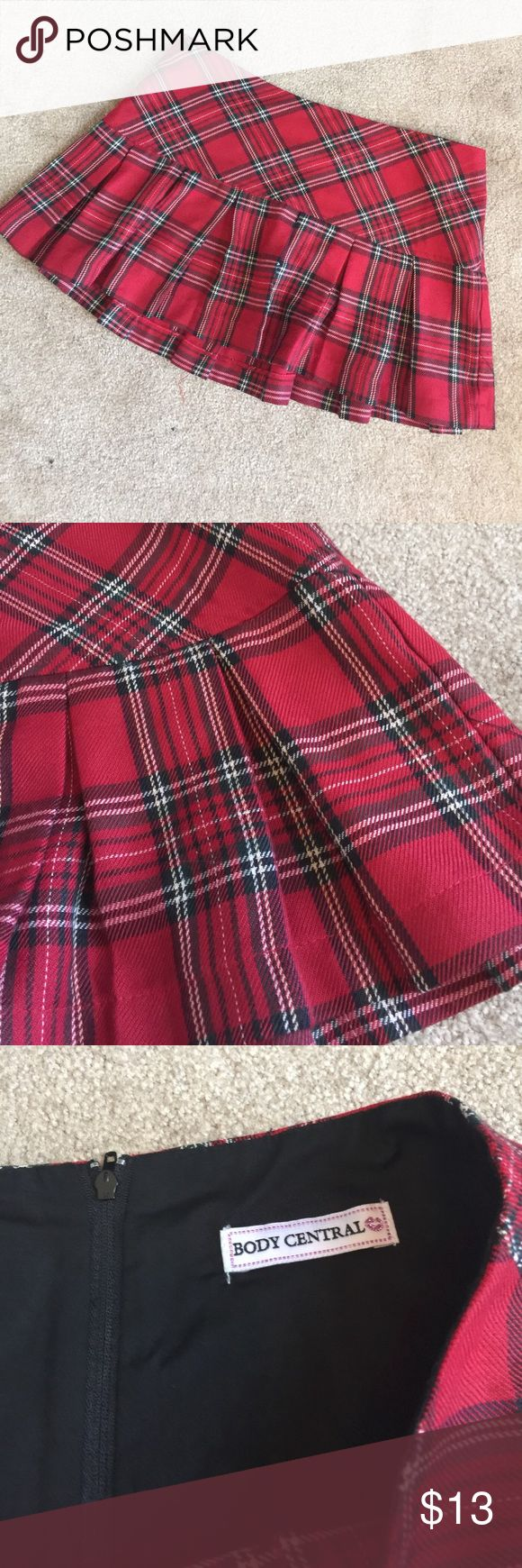 Red plaid pleated skirt Zipper back skirt. 11 inches long. 100% polyester. LB Body Central Skirts Mini