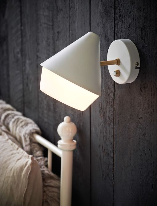 """GILIO wall lamp mid century design, Denmark.  Matte white metal, opal glass shade, brass details.  7.5"""" deep X 6"""" high.  Comes with 78"""" cord for pin up or can be direct wired.  Takes one E14 standard candelabra base bulb.  List $75."""