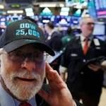 The Dow Jones industrial average tops 25000 for first time continuing its history-making rise