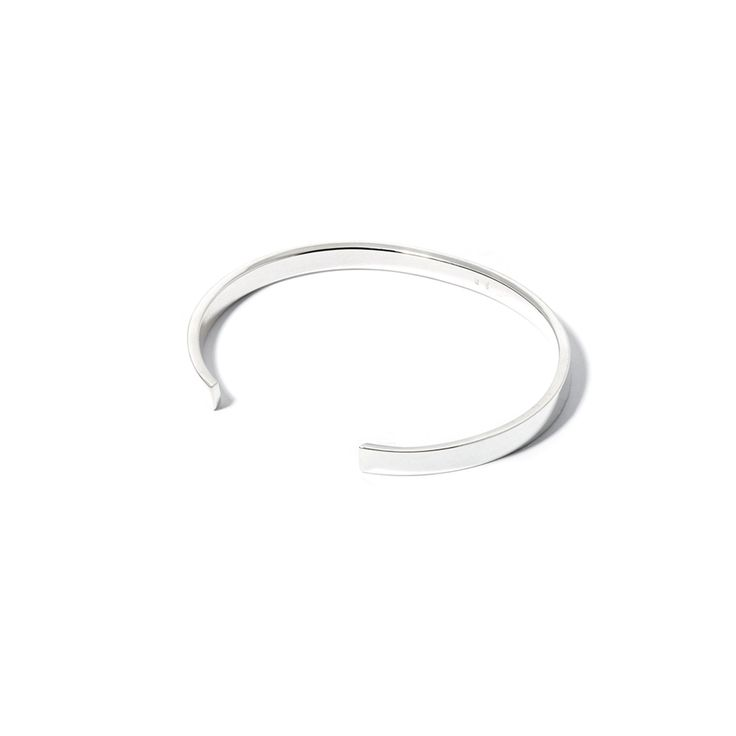 The Charmer Cuff by SARAH & SEBASTIAN is a band-style cuff crated in sterling silver featuring open detailing. Nickel free.