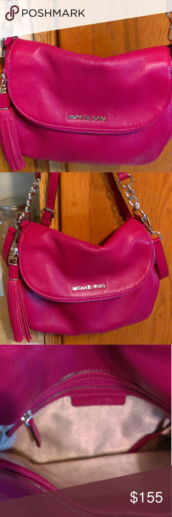 Michael Kors Raspberry Bedford bag Price firm!!Gorgeous Michael Kors raspberry Bedford bag in excellent condition. The color is a little deeper than pics. These aren't easy to find at this price especially. There's a small bend on short strap where was hung. There's some non noticeable scratches on silver hardware. It's shoulder with detachable crossbody strap. Higher tv Michael Kors Bags Crossbody Bags