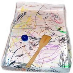 Toddler Air Hockey! (sans air)  Toddlers love to bat things around and here's a fun way to play a fun game with her. Take a piece of poster board and let your toddler color it with crayons and markers. Then fold each side of the paper about 2.5 inches. Then fold them up and tape the corners so that you make a sort of box top. See photo. Then let your toddler use a wooden spoon or small plastic ware cup to knock a ball around inside!