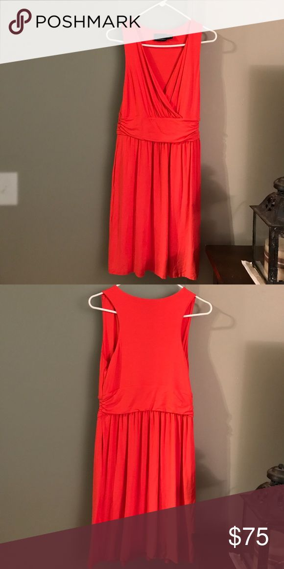 Coral sundress Coral Cynthia Rowley sleeveless dress. V neck with riches band around waist. So pretty and flattering on! Take it from work with a blazer and pumps to evening or go casual with sandals and a cute hat. Cynthia Rowley Dresses