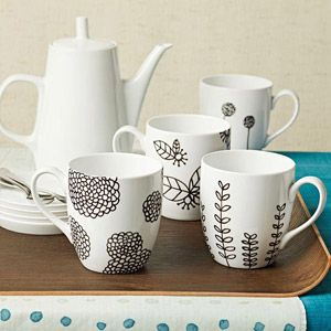 Painted Botanical Mugs Sketch sophisticated, organic designs on white ceramic mugs with an easy-to-use paint marker