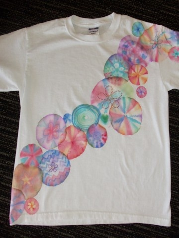 tie dye with sharpies ~~soo much fun! put shirt around a cup with rubberband, make design with Sharpie or other permanent marker, drop rubbing alcohol on center and watch it spread..added some iron on rhinestones for good measure and it is AWESOME!!
