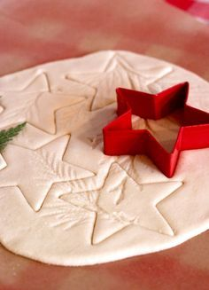 Clay Christmas Ornament Craft for Kids - Use pine needles or other greenery to make impressions in the dough // Worked really well! Used a little bit of whole wheat flour, which gave it a really rustic texture.:                                                                                                                                                                                 More
