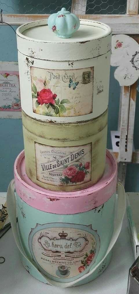 Painted & decoupaged tins / canisters / round boxes. Love the little blue Knob on top!