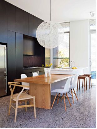 Island with pull-out dining table. Barstools and dining on same linear space.