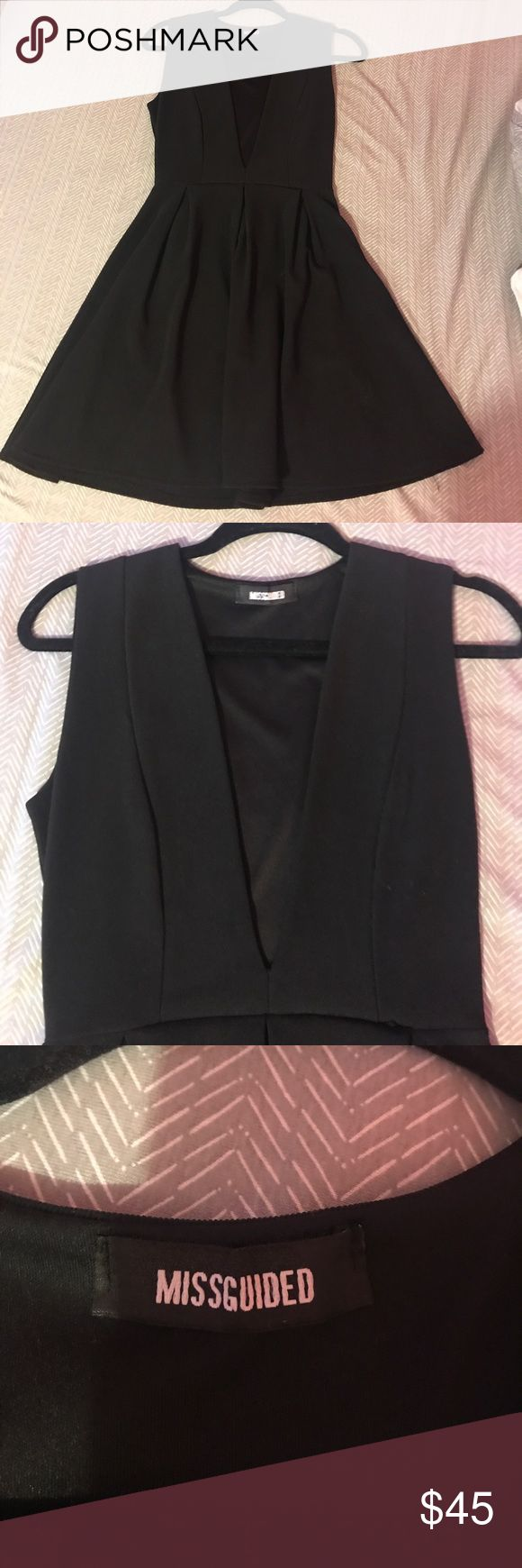 Black low cut Missguided dress Size 6 low cut dress that comes in in the middle and has a flowy bottom, 95% polyester Missguided Dresses Mini