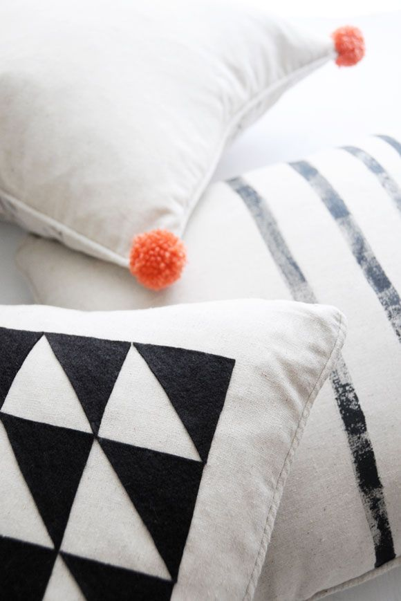 Is your living room sofa in need of some pizzazz? Tackle this #DIY design idea to create eye-catching accent pillows -- via Homedit.com