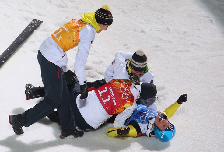 Severin Freund of Germany is mobbed by team-mates after the Men's Team Ski Jumping final round (c) Getty Images