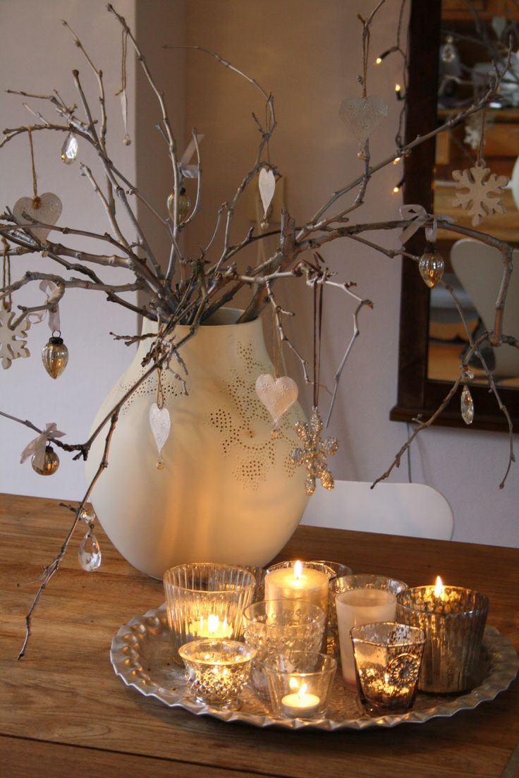 white jug on kitchen cabinet white clear or frosted bulbs on the branches