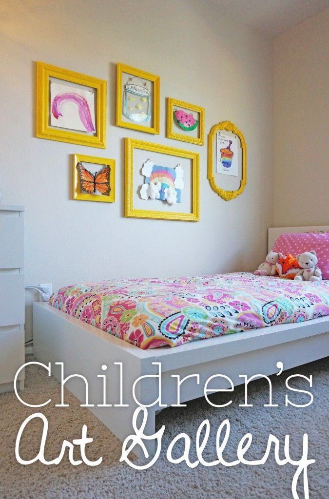 DIY Children's Art Gallery: use thrift store frames to make a changeable art display of your children's' art. | Yellow Bliss Road