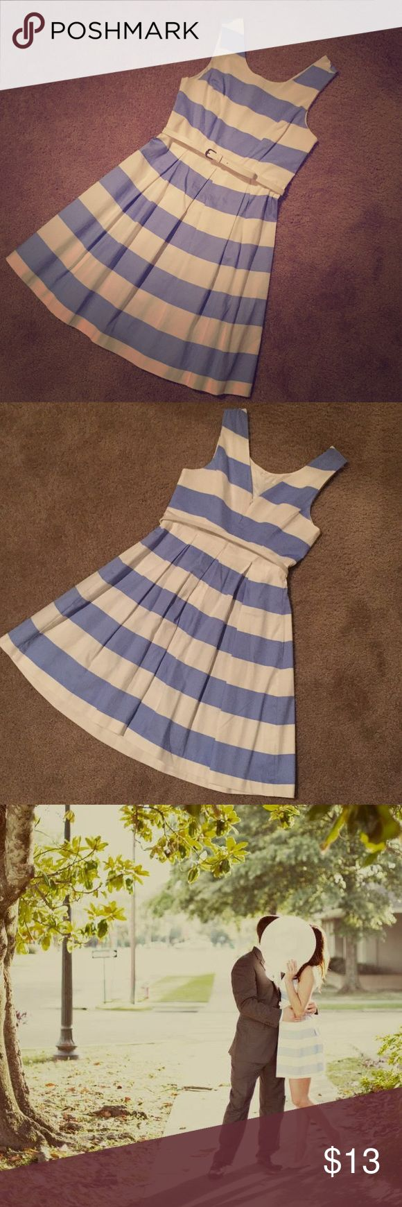 Forever 21 Blue & White Striped Dress I absolutely love this dress! Worn twice, once for my engagement photos and again in Disney for tea with Alice herself! This dress has a pleated skirt with a v-back. The V isn't too low so you can still wear a regular bra with it. Zips in the back. Comes with a thin white belt. Forever 21 Dresses