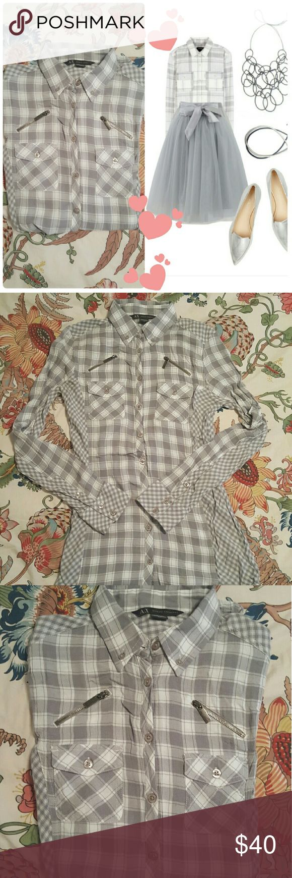 Armani Exchange gray plaid lightweight flannel Long and lean with zipper details, and varying plaid pattern on sides and wrists, this Armani Exchange blouse is just darling and long enough to wear with leggings! Very figure flattering add it hugs the waist and hips. Perfect for a casual day or dress it up! Size small or Xsmall would fit best, with some stretch to the lightweight material. Armani Exchange Tops