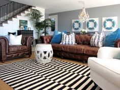 Decorating, living with, and loving, a brown sofa. Color scheme mix of patterns