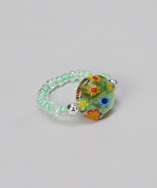 Accessorize sandals with this elasticized toe ring. Comfortable to wear, its stretchy beaded band complements the colors of the lively millefiori centerpiece.