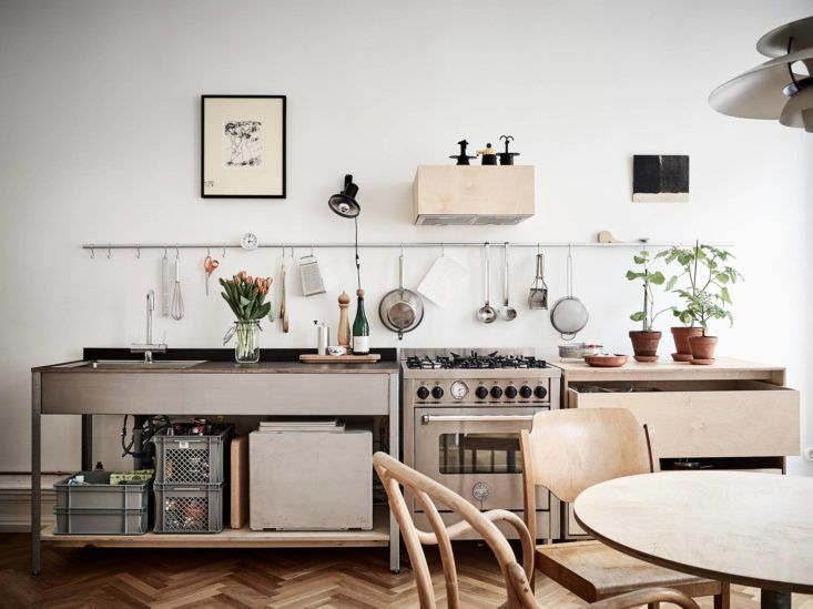 A Grundtal kitchen rail connected together creates one long rail across this makeshift kitchen in Sweden