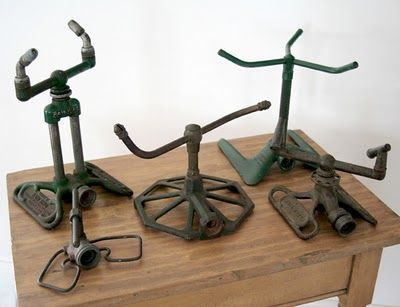 I have a small collection of old metal garden sprinklers similar to this bunch.  I think they are just so cool.