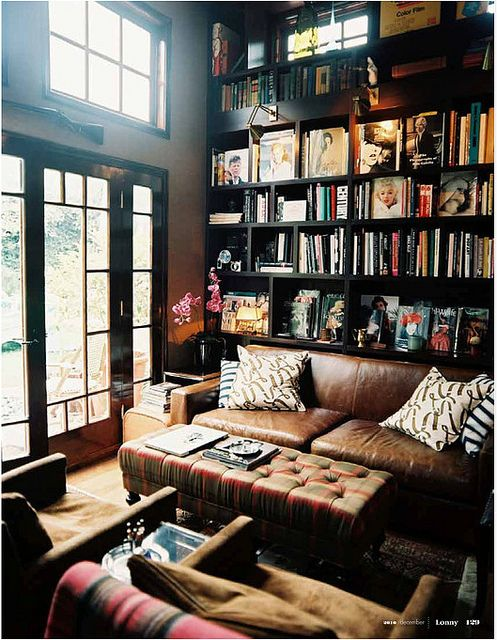 library, love the bookshelf + weathered leather sofa