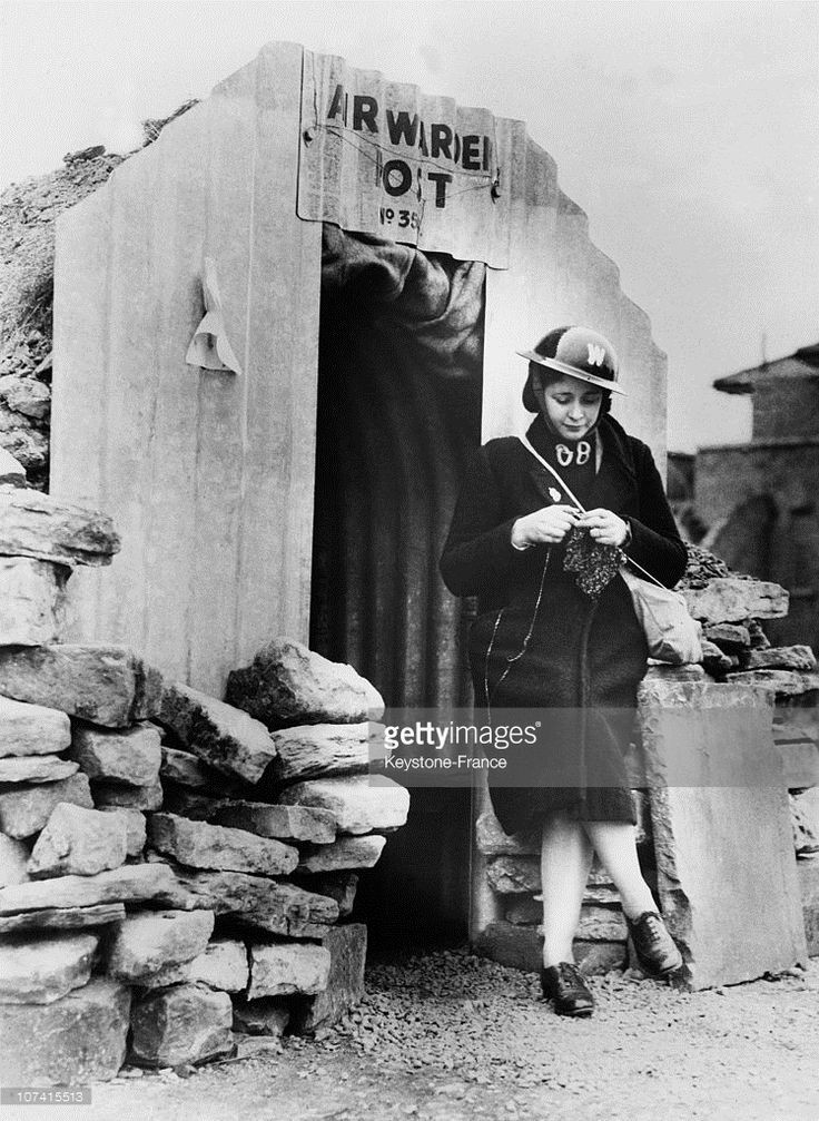 Woman Of The Civil Defence Knitting At The Entrance Of An Air Raid Shelter In London On 1939