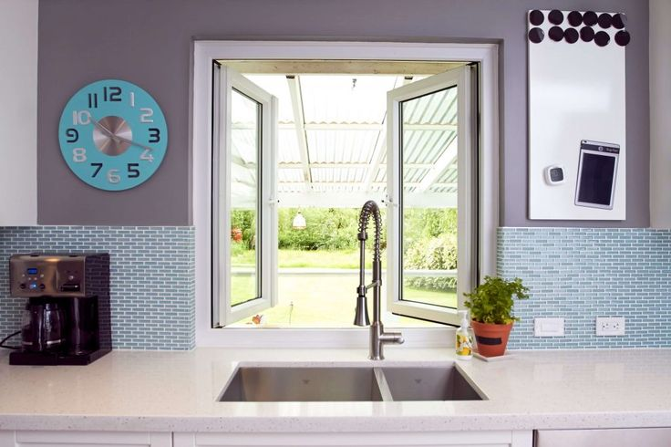 Image of our Centra 2700 Tilt & Turn Window which can be customized to open up for pass through access from the kitchen to the outside.