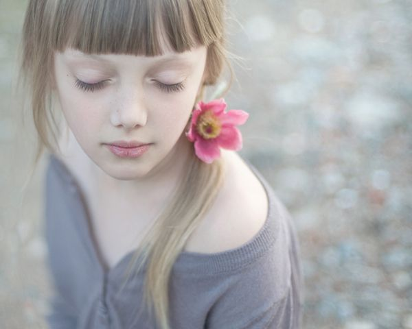 Stunning children photography by Magdalena Berny like this, kinda reminds me of c's face and hair, complexion.  the flower is lovely.   i like her face and the colors of the picture and it has an innocent, inner child vibe to it for me today.