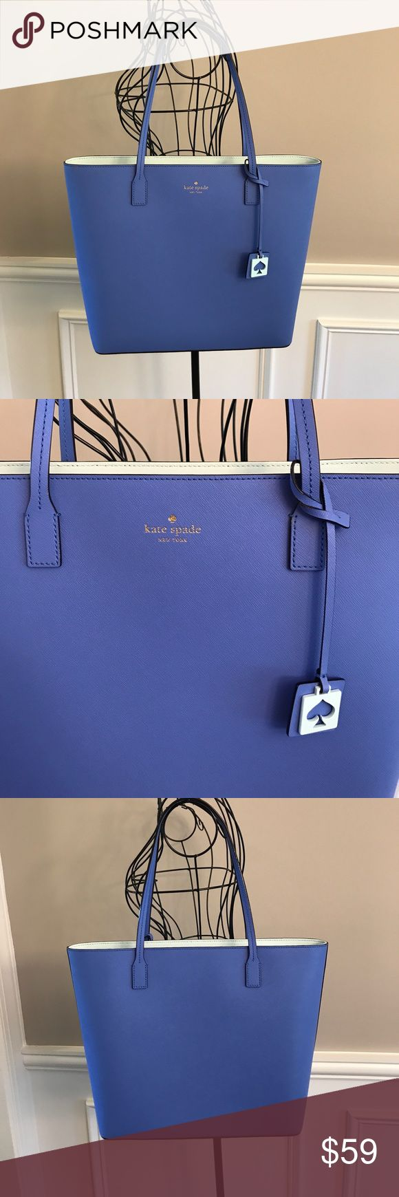 """Kate Spade Tote EUC I bought this Kate Spade bag from the KS outlet store in July for $89 (it was 60% off). I only used it a few times, and it's just sitting in my closet now so I'm selling it. It's light blue with a mint colored interior & details. Super clean, no flaws. Good as new. 13""""W, 12""""H, 4""""D, Strap drop 9"""". Very roomy bag. No dust bag. Offers welcome, discount for bundles. kate spade Bags Totes"""