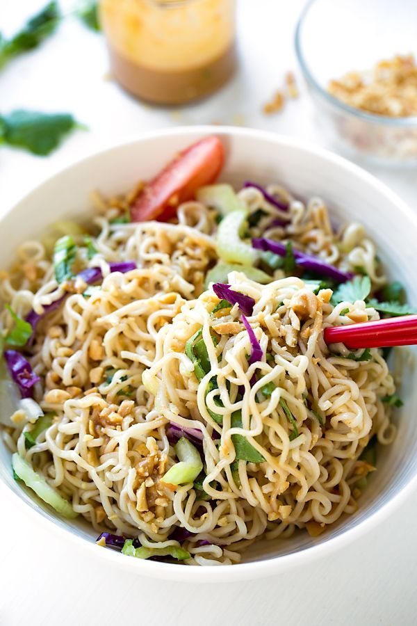 This cool ramen noodle salad packed with bright bok choy and purple cabbage, and tossed with a flavorful peanut vinaigrette is a delicious and nutritious lunch or quick snack made with only 10 ingredients! #ramennoodlerecipes #ramenrecipes #ramennoodlesalad #ramennoodles