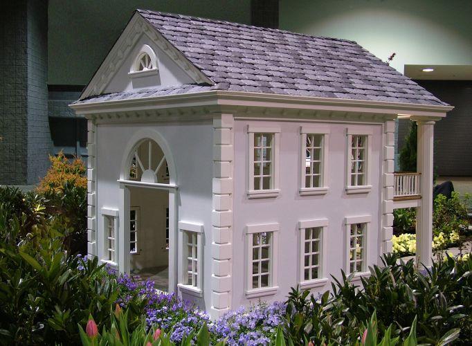 """Projetada pela """"La Petite Maison"""", a casinha para cachorro """"Celebrity Georgetown"""" conta com iluminação, água corrente e sistemas para aquecimento e ar condicionado"""