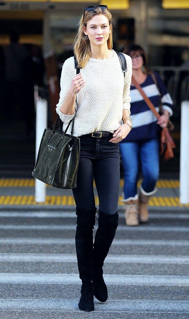 Karlie Kloss's over-the-knee boots only lengthen her supermodel stems.