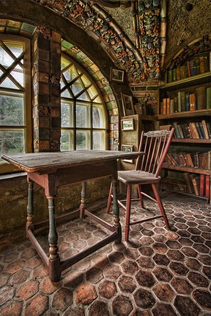 Library loft at Fonthill, a historic Arts and Crafts mansion in Pennsylvania, made of poured concrete. I can see myself sitting right there, dreamily staring out the window.
