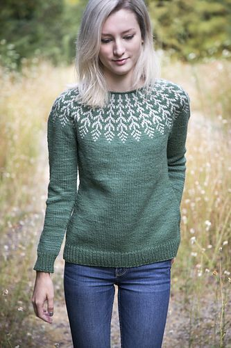 A top-down Icelandic-inspired stranded yoke sweater. This pullover is worked seamlessly from the top down, starting with a simple rolled neckline. The yoke is knit in stranded color work, then short row shaping is added to the back of the sweater to shape the shoulders and neckline. Gentle waist shaping makes for a flattering, feminine fit.